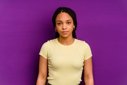 Young african american woman isolated on yellow background Young african american woman isolated on yellow background sad, serious face, feeling miserable and displeased.