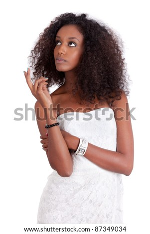 Young African American woman looking up, isolated on white background