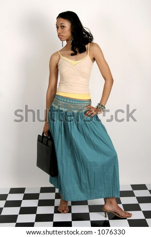 Young African American woman standing with portfolio in her hand