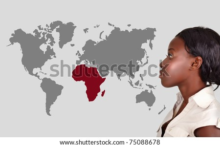 young African American woman thinking and looking at the world map with Africa in red.