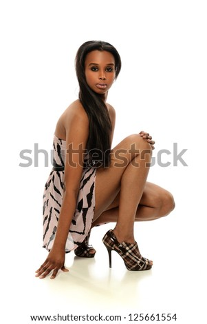 Young African American Woman wearing a dress isolated on a white background