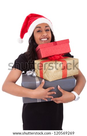 Young African American woman wearing a santa hat holding gift boxes, isolated on white background