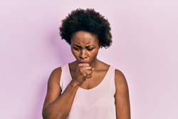 Young african american woman wearing casual sleeveless t shirt feeling unwell and coughing as symptom for cold or bronchitis. health care concept.