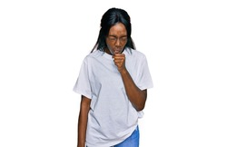 Young african american woman wearing casual white t shirt feeling unwell and coughing as symptom for cold or bronchitis. health care concept.
