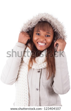 Young african american woman wearing winter clothes, isolated on white background
