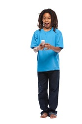 young african boy posing with cellphone in studio