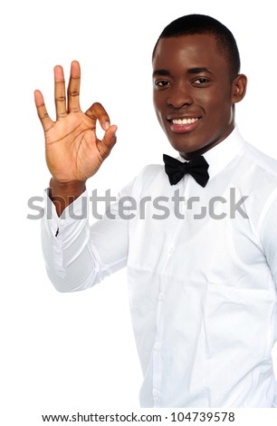 Young african boy showing okay gesture to camera