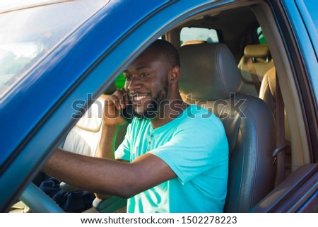 young African man driving his car and making a phone call #1502278223