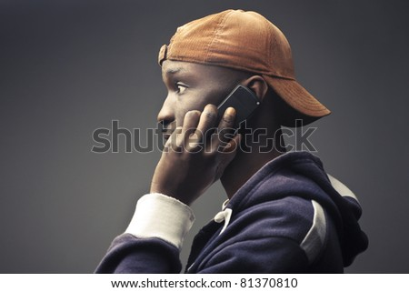 Young african man talking on the mobile phone