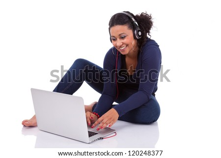 Young African student girl using a computer, isolated on white background