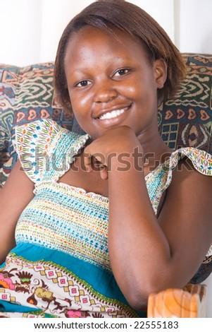 young african teenager girl on sofa portrait