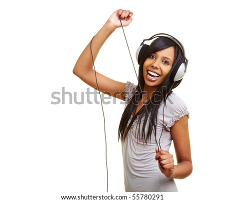 Young african woman dancing to music with headphones