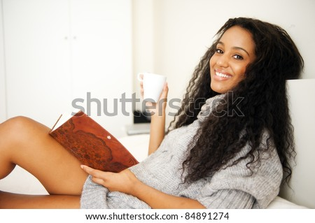 Young african woman in her bedroom
