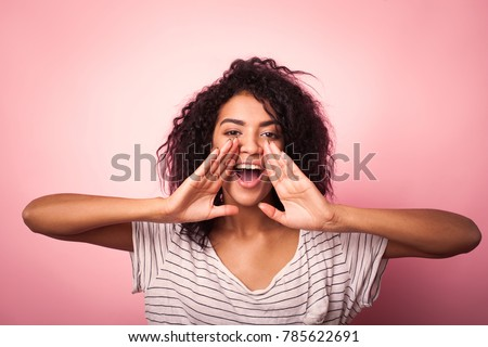Young african woman shouting on pink background #785622691