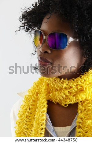 young African woman with fun disco sunglasses.