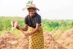 young African woman working on a farm
