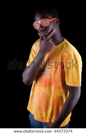 Young afro american teenager isolated over black background.