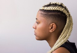 Young afro with blonde Box braids, African hair style also known as