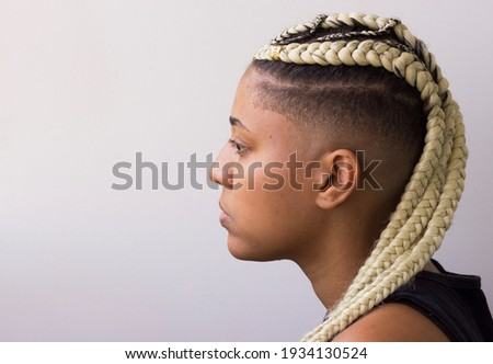 Young afro with blonde Box braids, African hair style also known as 'Kanekalon braids.' Close up on decoration and style. Copy space. Stock photo ©