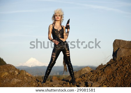 Stock Photo Young alternative woman with dual automatic pistols.