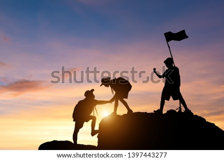 Young American Boy Scouts Help pull up from the cliff. Stock photo ©