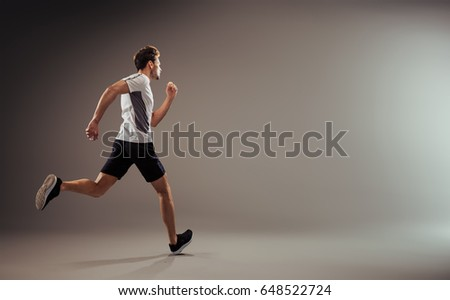Young and active jogger running  - isolated #648522724