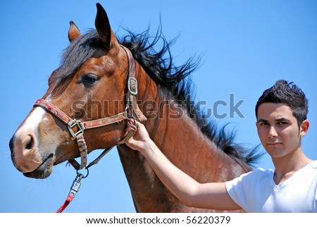 young and attractive man riding brown horse