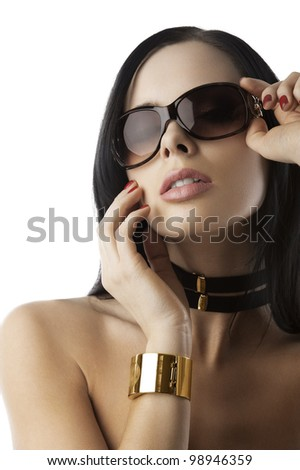 young and beautiful brunette with sunglasses and fashion accessories over white taking pose