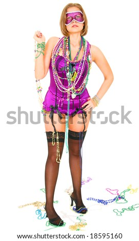 young and beautiful caucasian in colorful mardi gras dress wearing a lot of beads