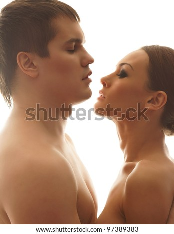 Young and beautiful couple isolated on white