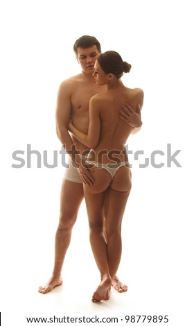 Young and beautiful couple isolated on white - stock photo
