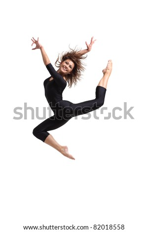 young and beautiful dancer jumping in studio