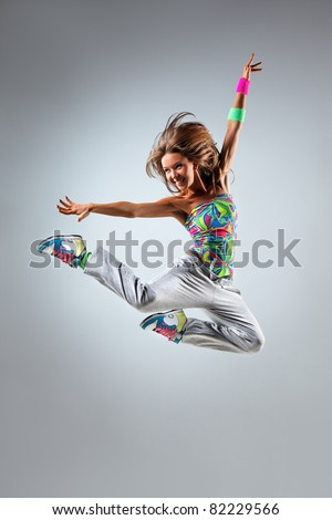 young and beautiful dancer posing in studio - stock photo