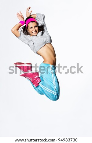 young and beautiful dancer posing on studio background