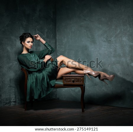 Young and beautiful fashion model over vintage and shabby background