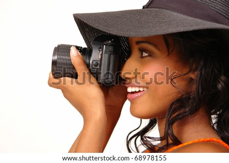 Young and beautiful female loves to photograph with her 35 mm camera.