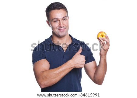 young and beautiful man holding a red apple and making ok sign