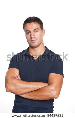 young and beautiful man standing with his arms crossed