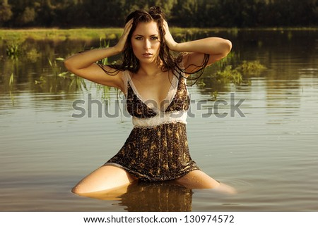 Young and beautiful sexy girl in the river.
