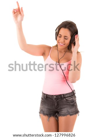 Young and beautiful woman listening to music