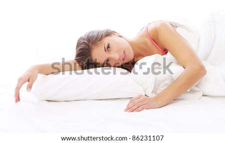 Young and beautiful woman relaxing in bed at morning