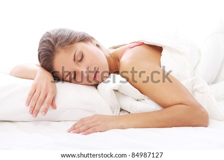 Young and Beautiful woman sleeping in bed