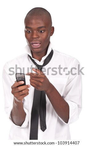 young and black man holding a cellphone and looking surprised