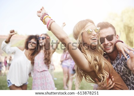 Young and cheerful couple in music festival #613878251