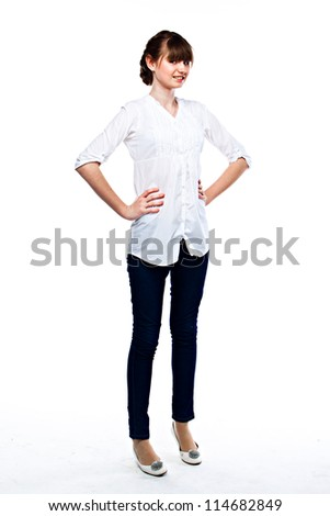 Young and funny girl in a white shirt and dark blue jeans