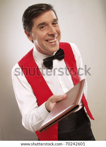 Young and funny waiter portrait on white background.