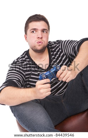 young and furious man with a joystick for game console