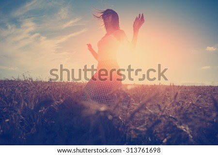 Young and handsome girl dancing outdoors at sunset #313761698