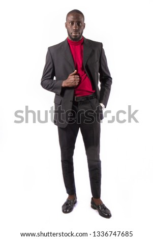 Young and handsome. Handsome young African senegalese man in smart casual jacket holding hands in pockets and traditional smiling while standing against white background #1336747685