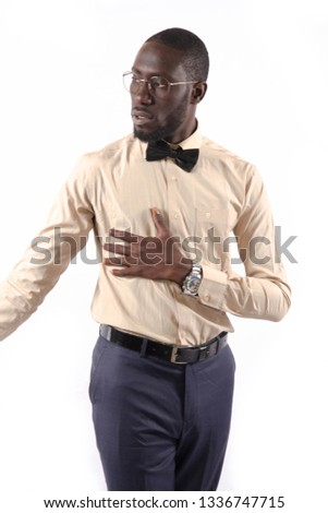 Young and handsome. Handsome young African senegalese man in smart casual jacket holding hands in pockets and traditional smiling while standing against white background #1336747715